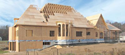 New House with Roof Trusses under Construction